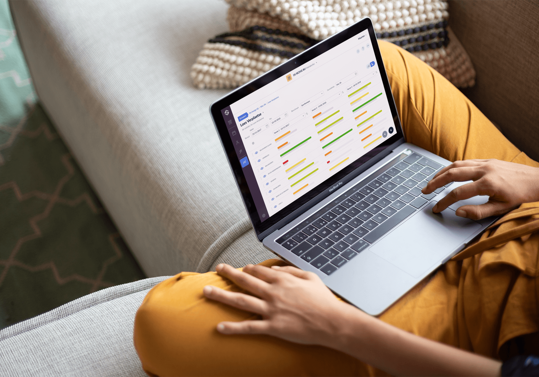 woman-working-with-a-macbook-mockup-sitting-on-a-sofa-a21180